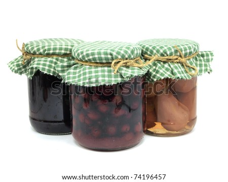 pickled pear,  plum jam and preserved cherries in glass jars on white background