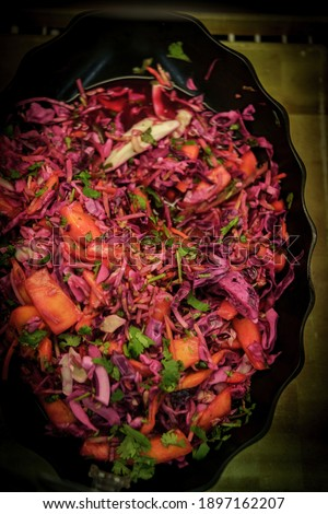 Pickled red cabbage and mango coleslaw on display at local deli Stockfoto ©