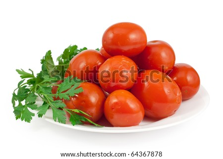 Pickled red tomatoes with green parsley. Isolated on white background with clipping path. - stock photo