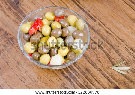 Pickles and olives on wood table