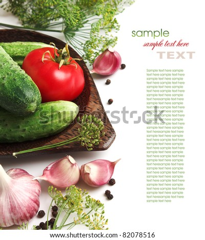 pickling cucumbers and spices isolated on white background