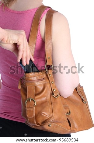 Pickpocketing a mobile out of a handbag of a woman