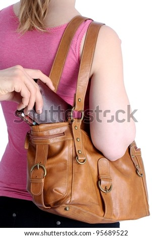 Pickpocketing a wallet out of a handbag of a woman