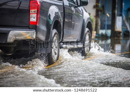 Pickup truck on a flooded street #1248691522