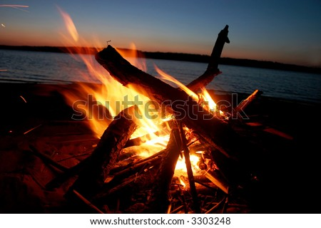 Picnic. A fire on coast of the river