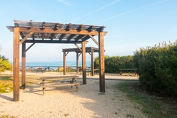 Picnic area near the sea. Wooden structure. Beautiful spot to relax and have a snack.