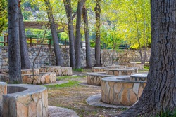 Picnic area, with tables and chairs built with stones, in Sot de Chera, Valencia (Spain)