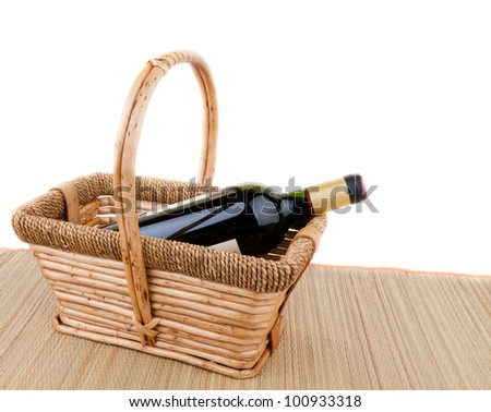 picnic basket with a bottle of wine