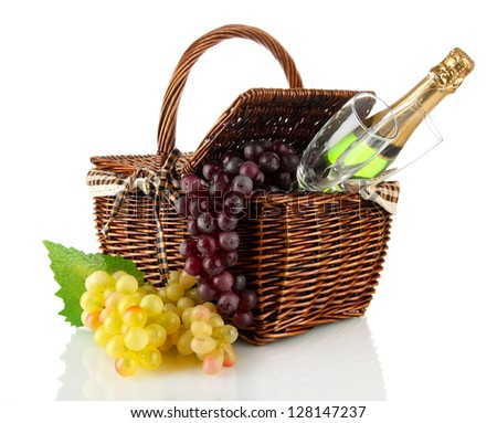 Picnic basket with fruits and bottle of champagne isolated on white