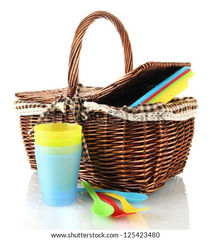 Picnic basket with fruits and  tableware isolated on white