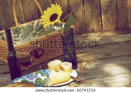 Picnic for two with wine, bread and cheese.