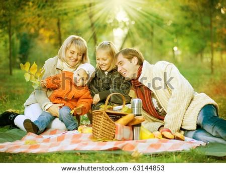 Picnic. Happy Family in Autumn Park