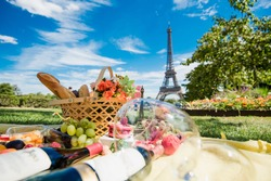 Picnic in Paris with wine, fruits and different french tasty dishes