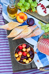 Picnic on the beach at sunset in the style of boho. Food and drink, relax, holiday concept