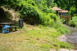 Picnic spot in the countryside, with benches and a waste bin