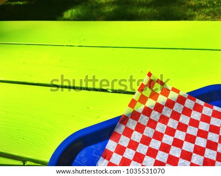 Picnic table in the summertime sun #1035531070