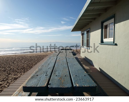 Picnic tables in front of a lifeguard office building