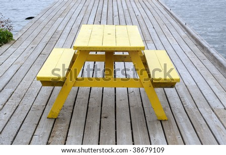 Picnic tables on a wooden dock