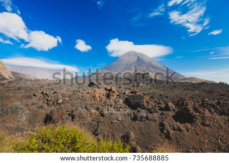 Pico do Fogo, volcano on the island of Fogo on Cabo Verde islands, with some grass and rocks in the foreground. #735688885