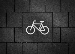 Pictogram of a bicycle on the asphalt