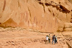 Pictographs found on the Great Wall in Horseshoe Canyon, Utah.  Some of the most significant rock art in North America. The tiny people emphasize how huge this amazing panel is.