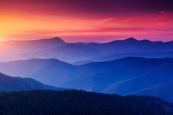 Pictorial mountains are illuminated by the evening light. Colorful cloudy sky. Location place of Carpathian national park, Ukraine, Europe. Splendid natural wallpaper. Discover the beauty of earth.