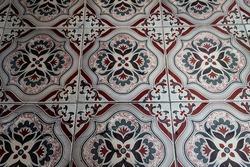 pictorial pattern on floor tiles