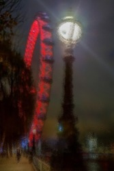 Pictural and abstract blur view with red carousel of dreams on the night. Glass filter applied.