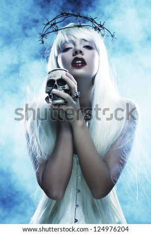Stock Photo Picture a beautiful angelic long hair woman with skull