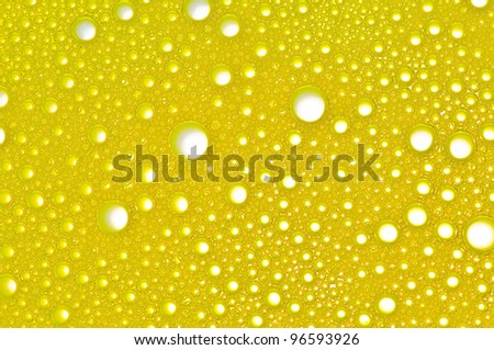 Picture a foam bubble yellow macro background.