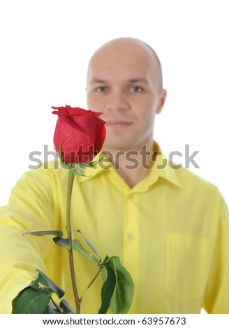 Picture a man in a yellow shirt holding a red rose. Isolated on white background