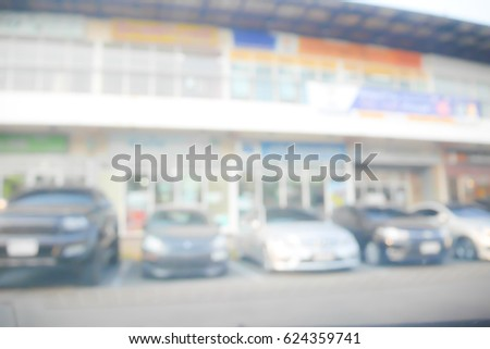 Picture blurred for background abstract and can be illustration to article of Cars parked in the parking lot #624359741