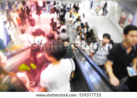 Picture blurred  for background abstract and can be illustration to article of People using the escalator