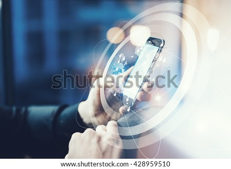 Picture businessman relaxing modern loft office. Man sitting in chair at night.Using contemporary smartphone. Digital Connections World Wide Interfaces Screen.Horizontal,film effect,blurred background #428959510