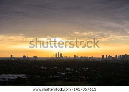 Picture for making a text background The morning city The sky is not clear, the sun shines on various buildings, when the sky is golden.