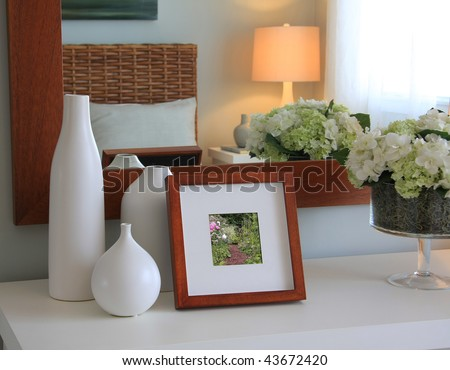 Picture frame and flowers on a dresser in a contemporary bedroom Picture in frame is mine.