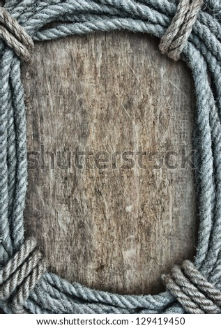 picture frame of rope on a old wooden background