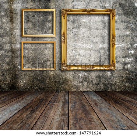 Picture frame put on wall in grunge room.