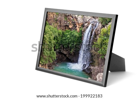 Picture frame with waterfalls landscape on the white background