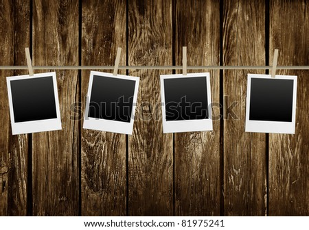 picture frames on a old wooden background