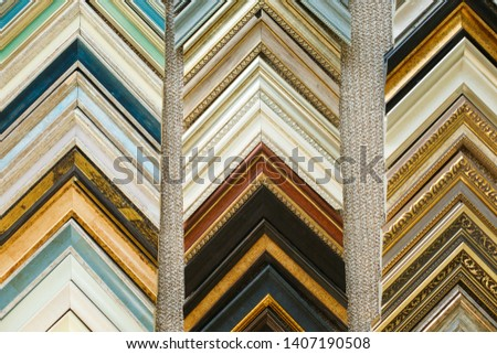 Picture frames samples in a workshop. Colorful samples of picture frames molding