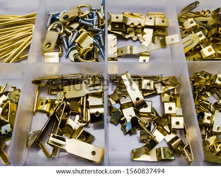 Picture hanging hardware. Assorted hardware for hanging pictures and mirrors etc. #1560837494