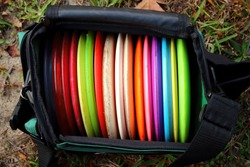 Picture of a bag full of disc golf discs