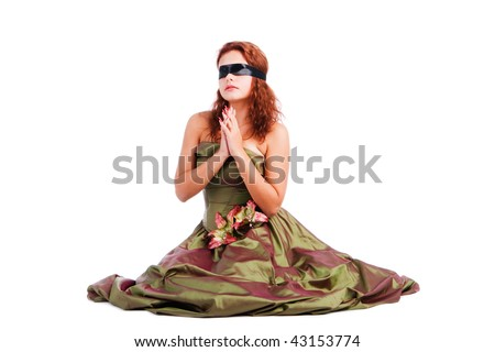 stock photo Picture of a beautiful blindfolded girl in dress on floor