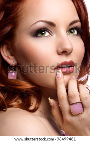 Picture of a beautiful woman with red hair wearing beautiful jewelry
