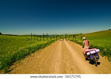 Picture of a bike rider in sunlight field