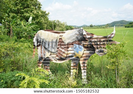 Picture of a buffalo made from zinc plate.