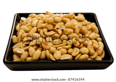 Picture of a bunch of peanuts on a black plate