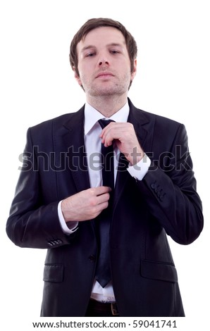 picture of a business man adjusting his tie over white