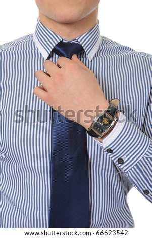 picture of a businessman adjusting his tie. Isolated on white background
